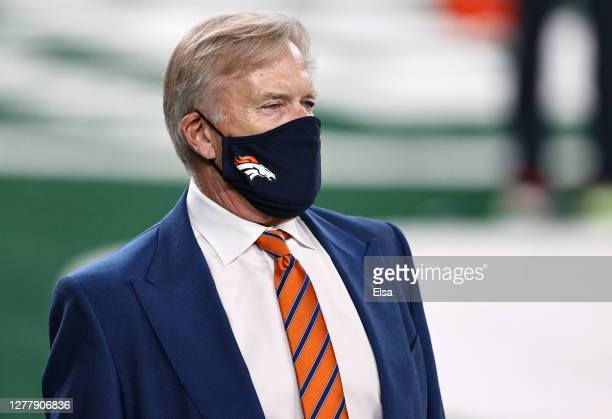 Denver Broncos President of Football Operations/General Manager John Elway looks on during warm ups against the New York Jets at MetLife Stadium on...