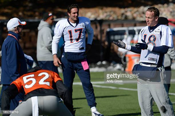 Denver Broncos QB Payton Manning right has a laugh with head coach John Fox left during practice Friday morning October 18 2103 Backup QB Brock...