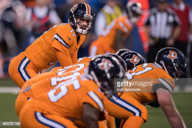 Denver Broncos quarterback Brock Osweiler calls out the play at the line of scrimmage during the NFL game between the Denver Broncos and Indianapolis...