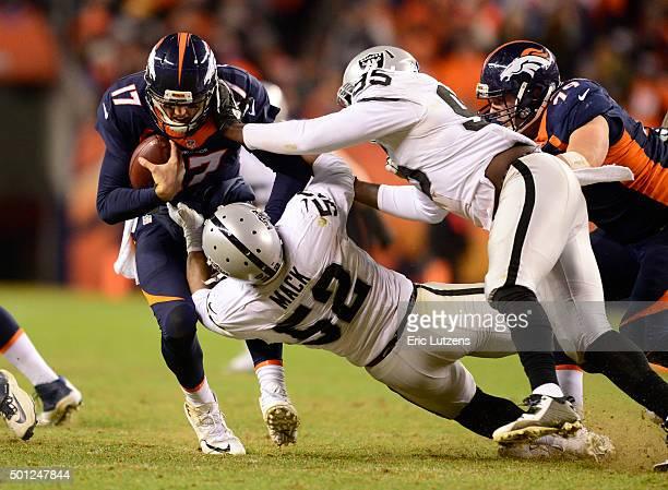 Denver Broncos quarterback Brock Osweiler gets sacked by Oakland Raiders defensive end Khalil Mack with help from Oakland Raiders defensive end...