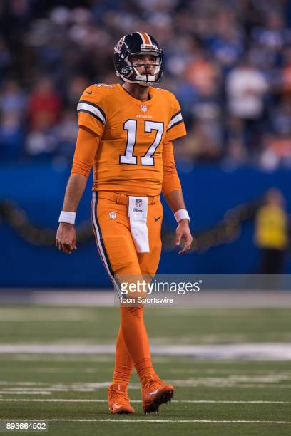 Denver Broncos quarterback Brock Osweiler watches a video replay on the scoreboard during the NFL game between the Denver Broncos and Indianapolis...