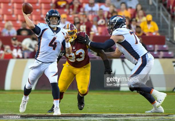 Denver Broncos quarterback Case Keenum completes a pass against the pressure of Washington Redskins defensive end Jonathan Allen on August 24 at...