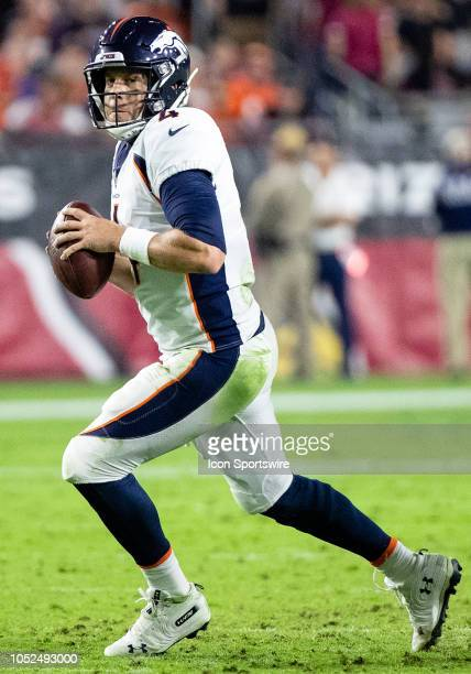 Denver Broncos quarterback Case Keenum rolls out for a pass during NFL football game between the Arizona Cardinals and the Denver Broncos on October...