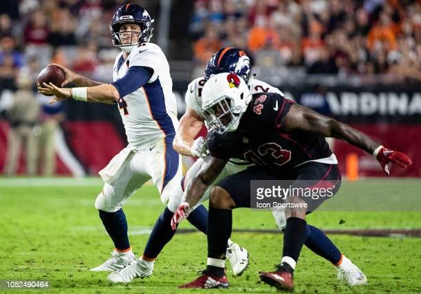 Denver Broncos quarterback Case Keenum throws a pass during NFL football game between the Arizona Cardinals and the Denver Broncos on October 18 2018...