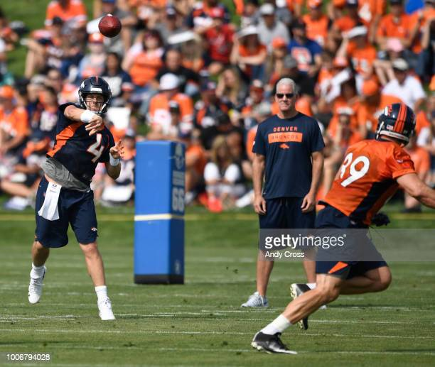 Denver Broncos quarterback Case Keenum throws to Denver Broncos tight end Brian Parker on the first day of Denver Broncos training camp at Dove...
