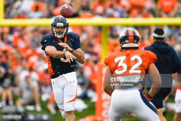 Denver Broncos quarterback Chad Kelly throws to fullback Andy Janovich during training camp on Friday August 3 2018