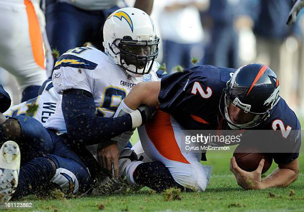 Denver Broncos quarterback Chris Simms right is sacked by the San Diego Chargers' Kevin Burnett left during the first quarter of play Sunday Nov 22...