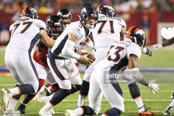 Denver Broncos quarterback Drew Lock looks to hand the ball off during the Hall of Fame Game between the Atlanta Falcons and the Denver Broncos...