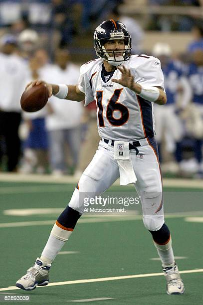 Denver Broncos quarterback Jake Plummer fades to pass at the RCA Dome Indianapolis Indiana January 4 2004 in an AFC wildcard playoff game