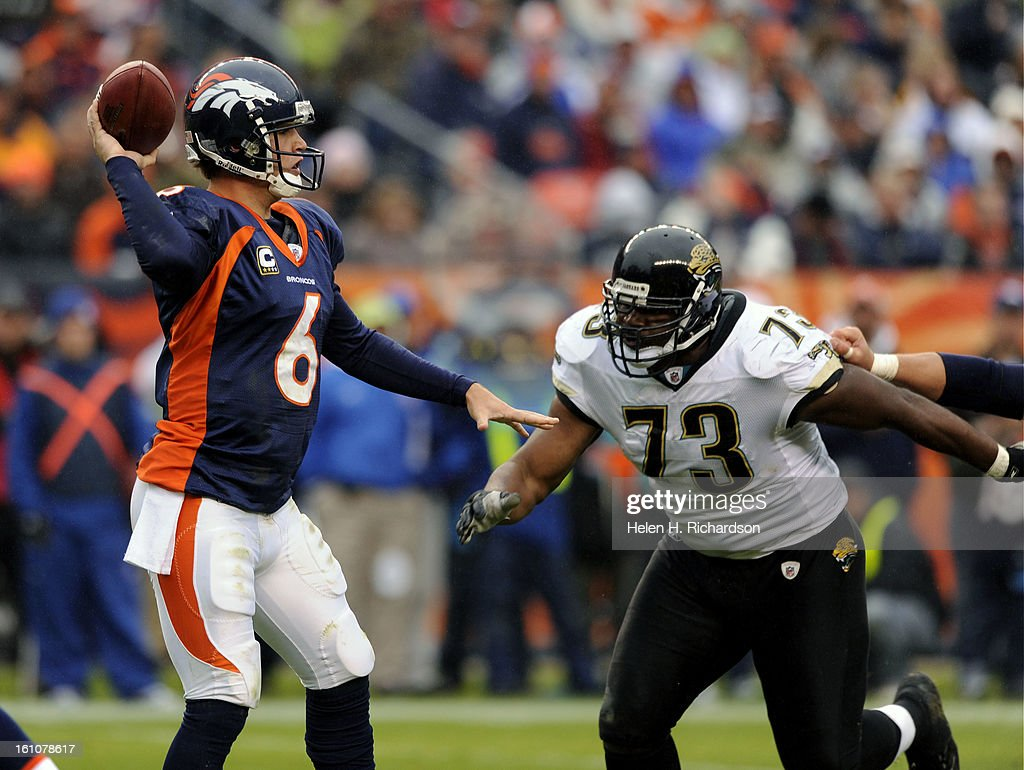 (HR) ABOVE: Denver Broncos quarterback Jay Cutler get pressure from Jacksonville Jaguars defensive tackle Jimmy Kennedy #73 in the fourth quarter. The Denver Broncos take on the Jacksonville Jaguars at Invesco Field at Mile High Stadium. The Broncos hope  : News Photo