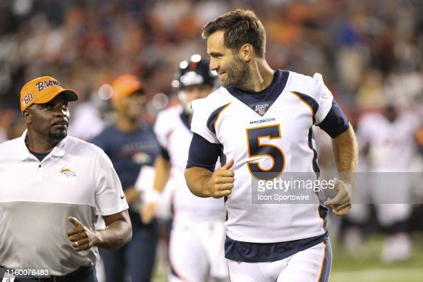 Denver Broncos quarterback Joe Flacco runs off of the field at the end of the first half during the Hall of Fame Game between the Atlanta Falcons and...