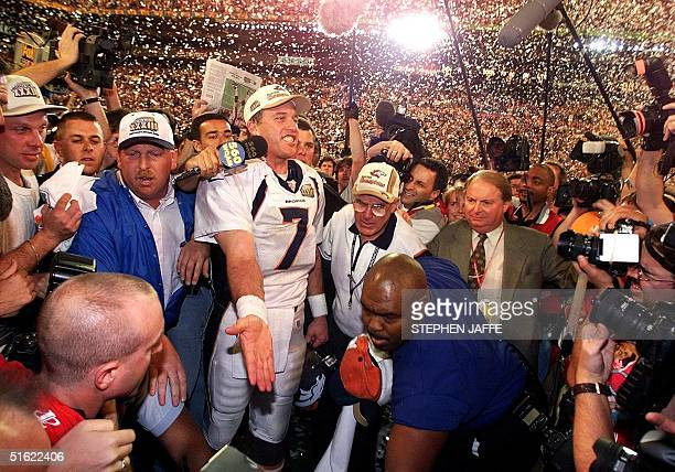 Denver Broncos quarterback John Elway MVP of the Super Bowl is surrounded by the media after beating the Atlanta Falcons in Super Bowl XXXIII 31...