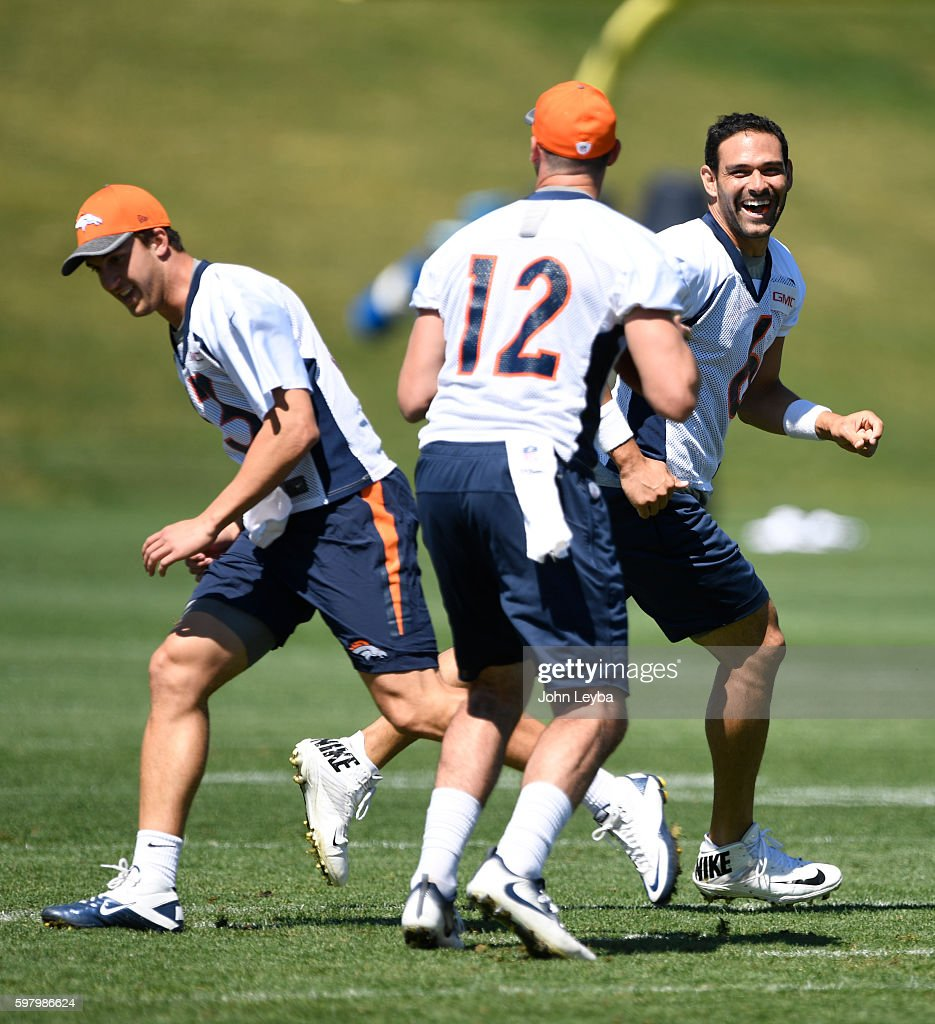 Denver Broncos quarterback Mark Sanchez (6) laughs as Denver Broncos quarterback Trevor Siemian (13) tries to distract Denver Broncos quarterback Paxton Lynch (12) during drills August 30, 2016 at Dove Valley.