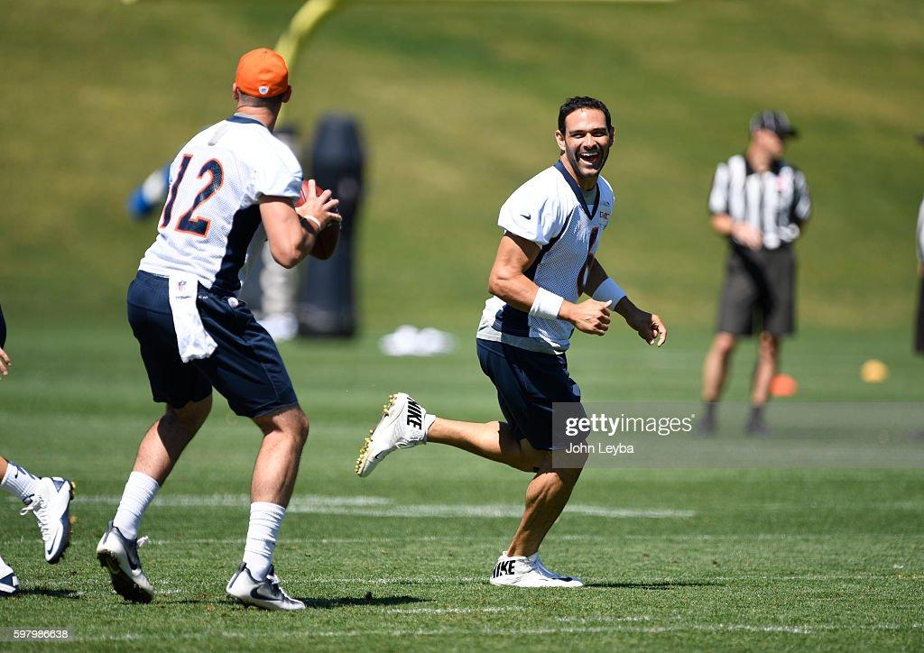 Denver Broncos quarterback Mark Sanchez (6) laughs as he tries to distract Denver Broncos quarterback Paxton Lynch (12) in drills during practice August 30, 2016 at Dove Valley.