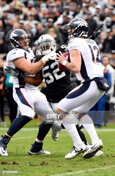 Denver Broncos quarterback Paxton Lynch drops back to pass during the first quarter on November 26 2017 in Oakland CA at OaklandAlameda County...