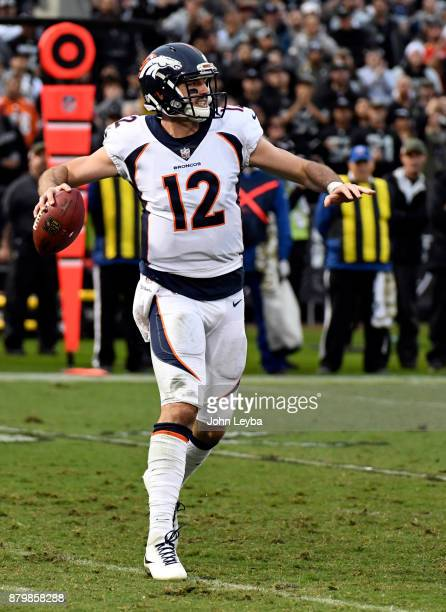 Denver Broncos quarterback Paxton Lynch throws a pass down field during the third quarter against the Oakland Raiders on November 26 2017 in Oakland...