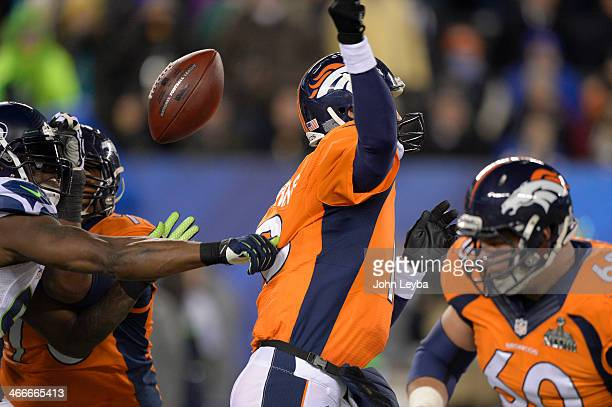 Denver Broncos quarterback Peyton Manning has the ball striped by Seattle Seahawks defensive end Chris Clemons during the fourth quarter the Seattle...