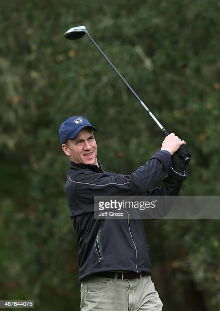 Denver Broncos quarterback Peyton Manning hits a tee shot on the 13th hole during the third round of the ATT Pebble Beach National ProAm at the...