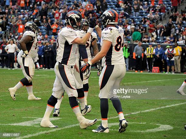 Denver Broncos quarterback Peyton Manning is congratulated by Denver Broncos tight end Jacob Tamme after throwing his 51st touchdown pass to Denver...