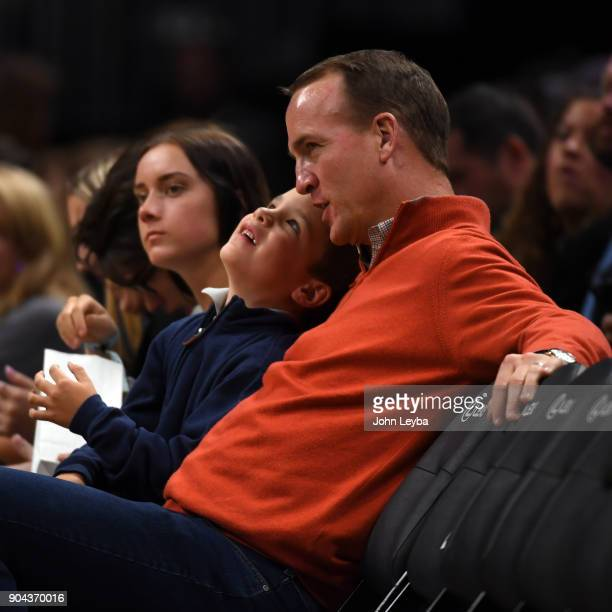 Denver Broncos quarterback Peyton Manning takes in the Denver Nuggets versus Memphis Grizzlies game with his son Marshall Manning on January 12 2018...