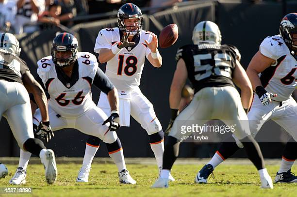 Denver Broncos quarterback Peyton Manning takes the snap in the second quarter against the Oakland Raiders November 9 2014 at Oco Coliseum