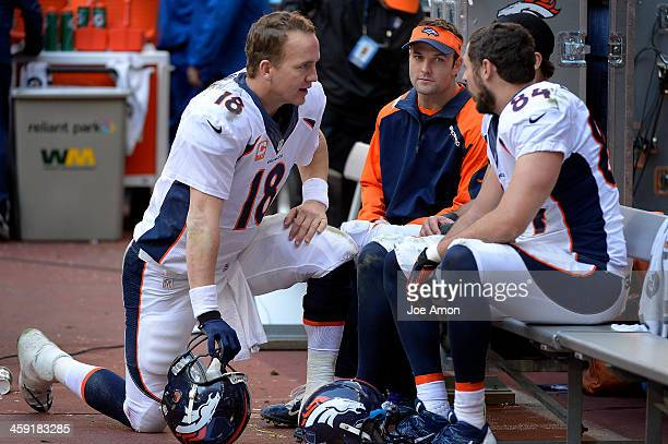 Denver Broncos quarterback Peyton Manning talks to wide receiver Wes Welker wide receiver Eric Decker and tight end Jacob Tamme in the second half...