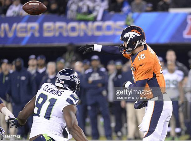 Denver Broncos quarterback Peyton Manning throws the ball past Chris Clemons of the Seattle Seahawks during Super Bowl 48 at MetLife stadium in East...