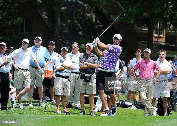 Denver Broncos quarterback Tim Tebow hits a drive from the first hole during the ProAm round for the FedEx St Jude Classic at TPC Southwind on June 8...