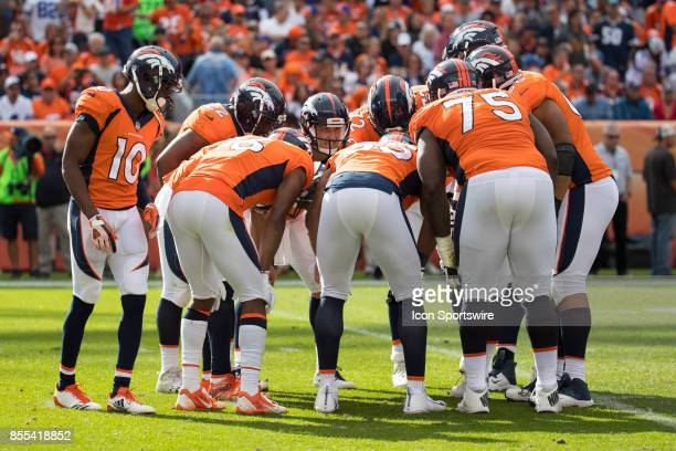 Denver Broncos quarterback Trevor Siemian calls the play in the huddle during a game between the Denver Broncos and the Dallas Cowboys on September...