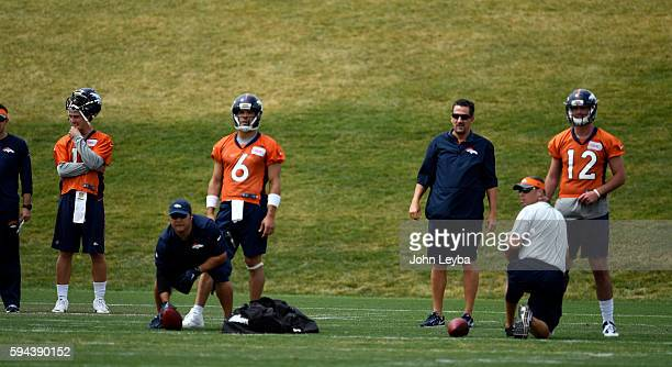 Denver Broncos quarterback Trevor Siemian Denver Broncos quarterback Mark Sanchez and Denver Broncos quarterback Paxton Lynch look on during practice...