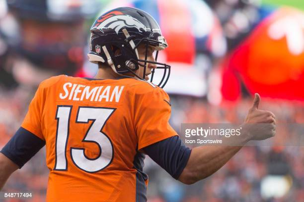 Denver Broncos quarterback Trevor Siemian gives a thumbs up during the NFL game between the Dallas Cowboys and the Denver Broncos on September 17...