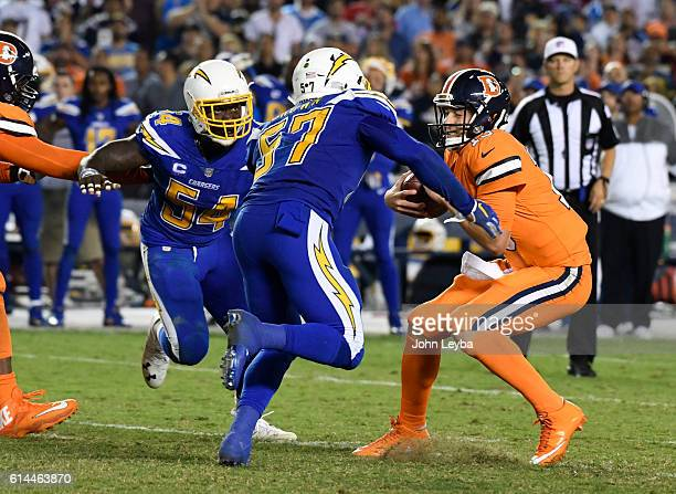 Denver Broncos quarterback Trevor Siemian prepares to get sacked by San Diego Chargers inside linebacker Jatavis Brown during the fourth quarter...