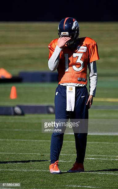 Denver Broncos quarterback Trevor Siemian rubs his eyes during practice October 20 2016 at Dove Valley as they prepare for the Houston Texans on...