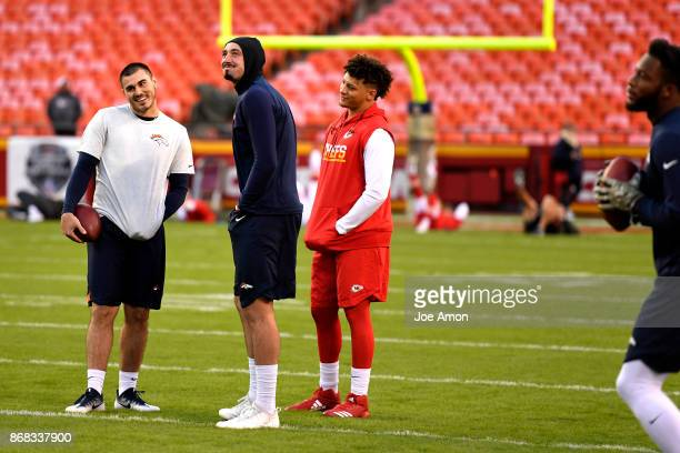 Denver Broncos quarterbacks Chad Kelly and Paxton Lynch and Kansas City Chiefs quarterback Patrick Mahomes on the field early for warm ups before the...