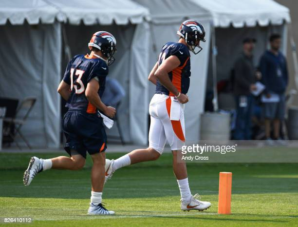 Denver Broncos quarterbacks Trevor Siemian left and Paxton Lynch take the field at Dove Valley August 04 2017