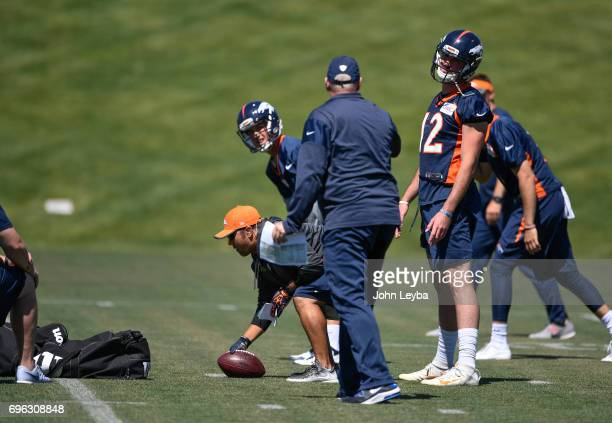 Denver Broncos quarterer backs coach Bill Musgrave works with Denver Broncos quarterback Paxton Lynch and quarterback Trevor Siemian during practice...