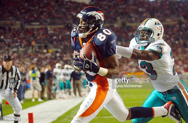 Denver Broncos Rod smith catches a pass in the endzone for a potential TD but was called out of bounds as he gets shoved by Miami Dolphins Patrick...