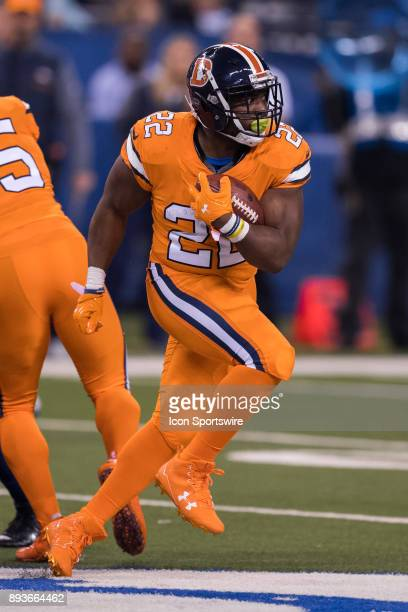 Denver Broncos running back CJ Anderson breaks through the line for a first down during the NFL game between the Denver Broncos and Indianapolis...