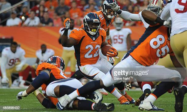 Denver Broncos running back CJ Anderson cuts back to pick up extra yards in the first half against the San Francisco 49ers at Sports Authority Field...