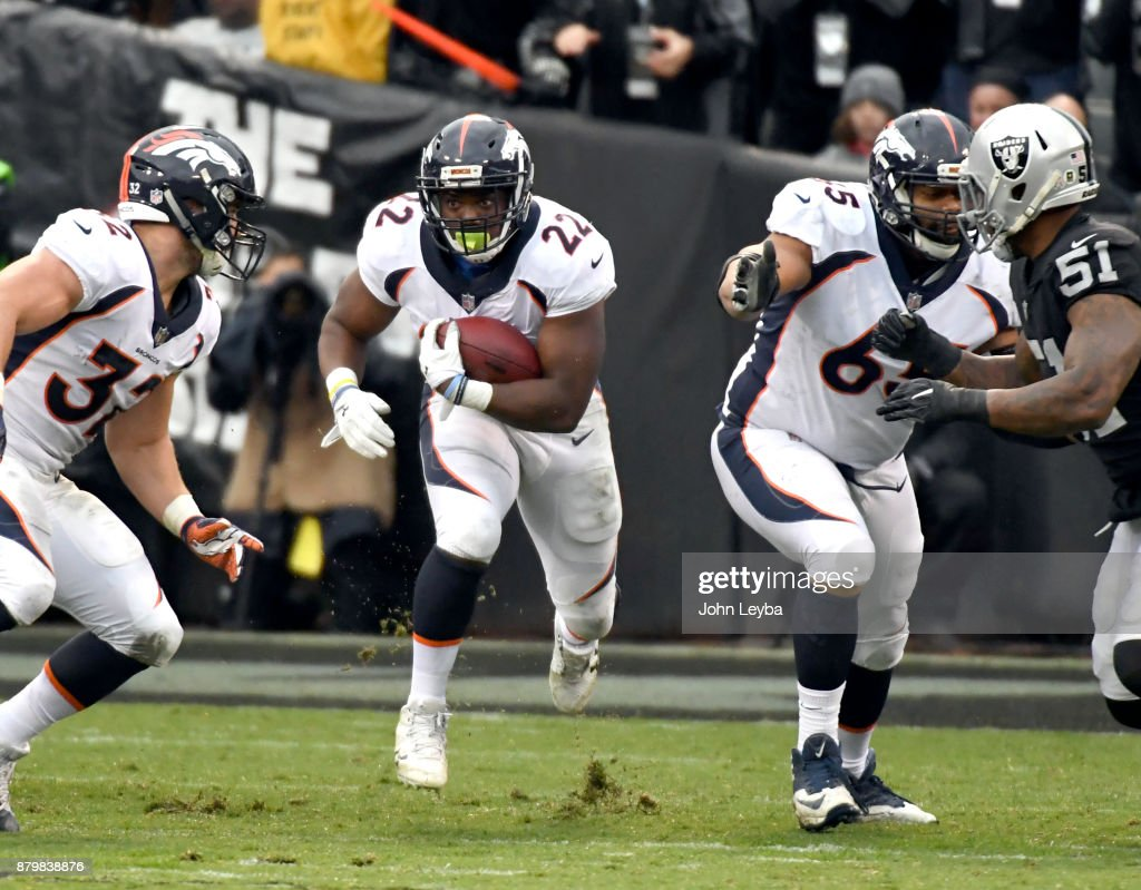 Denver Broncos running back C.J. Anderson (22) finds a hole in the Oakland Raiders defense during the first quarter on November 26, 2017 in Oakland, CA at Oakland-Alameda County Stadium.