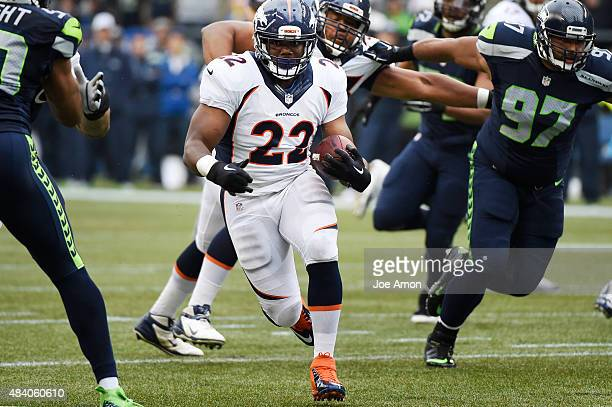 Denver Broncos running back CJ Anderson finds open field in the preseason game between the Seattle Seahawks and the Denver Broncos at CenturyLink...