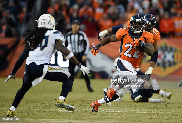 Denver Broncos running back CJ Anderson picks up a big gain as San Diego Chargers strong safety Jahleel Addae comes in on defense during the third...