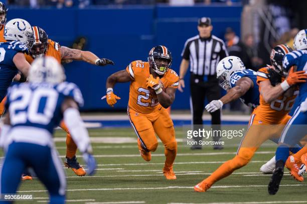 Denver Broncos running back CJ Anderson runs through a hole in the line during the NFL game between the Denver Broncos and Indianapolis Colts on...