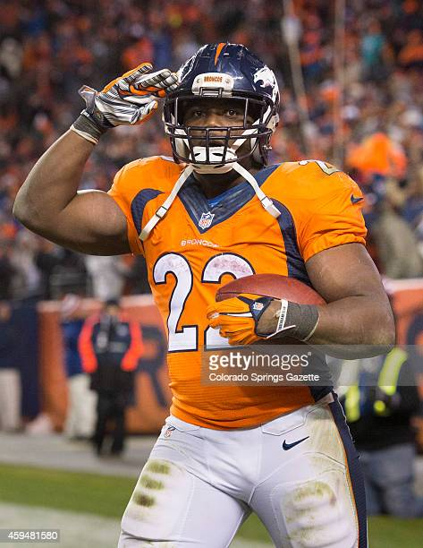 Denver Broncos running back CJ Anderson salutes the fans after scoring on a fourth quarter 10yard touchdown run that put the Broncos ahead for the...