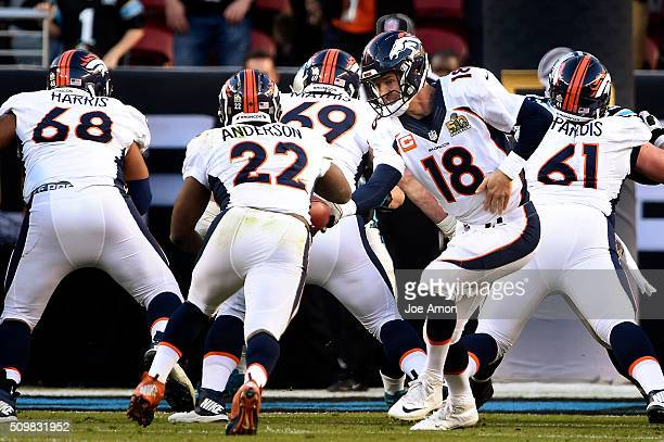 Denver Broncos running back CJ Anderson takes a handoff from quarterback Peyton Manning against the Carolina Panthers in Super Bowl 50 at Levi's...