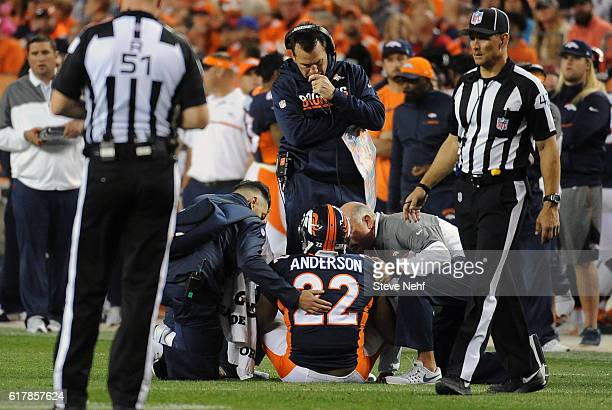 Denver Broncos running back CJ Anderson was slow to get up after breaking a big run in the second quarter against the Houston Texans at Sports...
