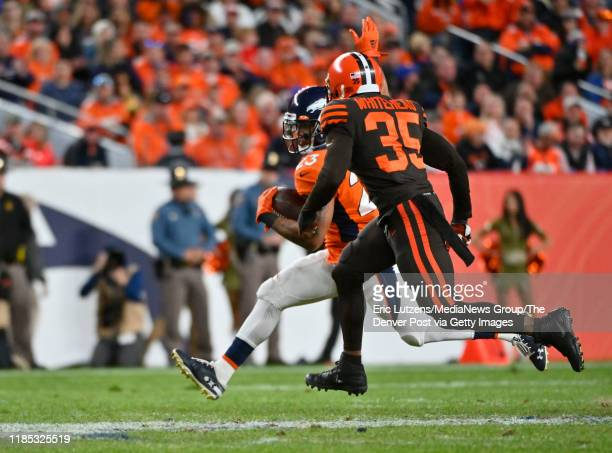 Denver Broncos running back Devontae Booker gets chased down by Cleveland Browns defensive back Jermaine Whitehead during the fourth quarter of the...