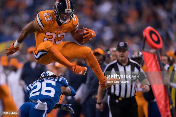 Denver Broncos running back Devontae Booker jumps over Indianapolis Colts safety Clayton Geathers for a long touchdown run that was called back on a...
