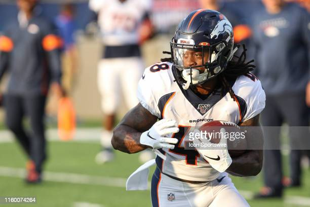 Denver Broncos running back Devontae Jackson carries the ball during warmups prior to the start of the Hall of Fame Game between the Atlanta Falcons...