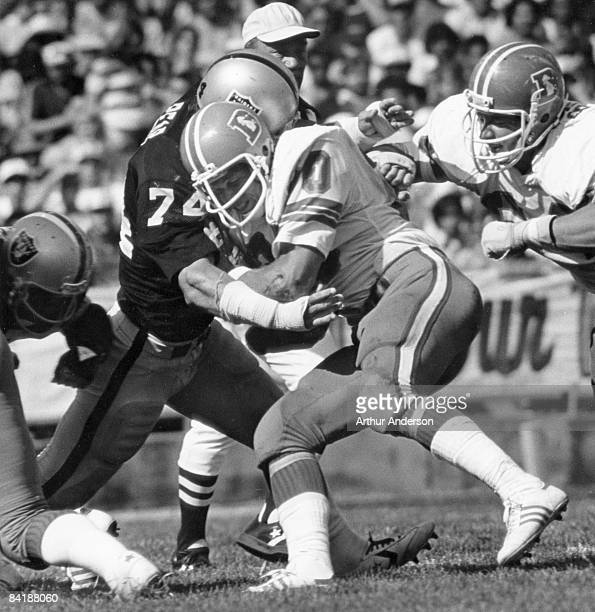 Denver Broncos running back Jim Jensen runs into Oakland Raiders nose tackle Dave Pear during a 27-3 Raiders victory on September 30 at the Oakland...
